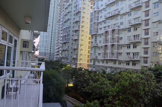 Located at Serendra 2 Building B , the balcony has a view of the inner garden