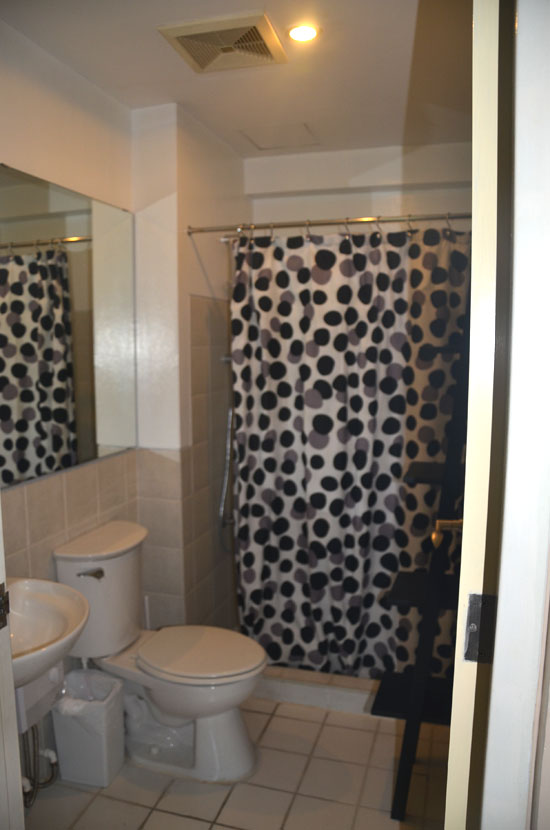 Common bathroom across the small bedroom