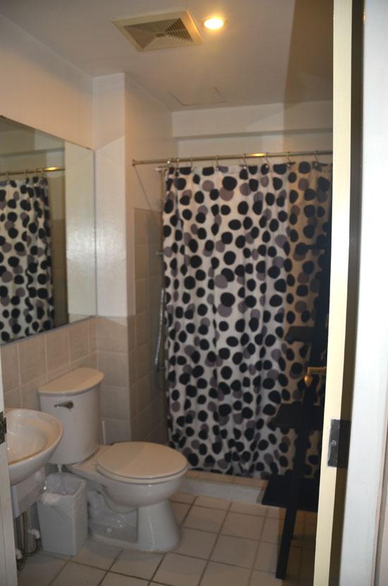 Common bathroom across the small bedroom