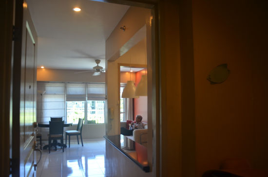 View from the door. To the right is the kitchen and the view of the living room and the dining room. Balcony is across the entrance door.